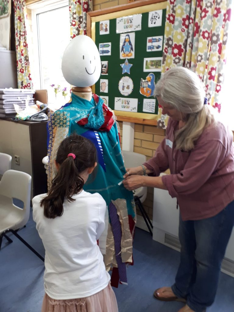 Joseph's multicoloured coat being created at Messy Church