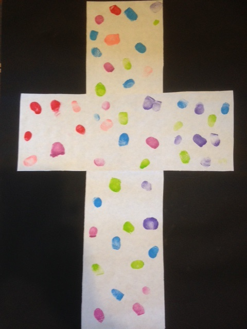 An image of the cross, made from the fingerprints of members of the congregation.